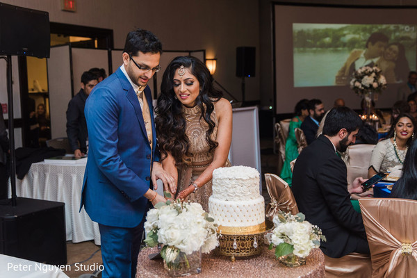 Indian bride cutting the cake