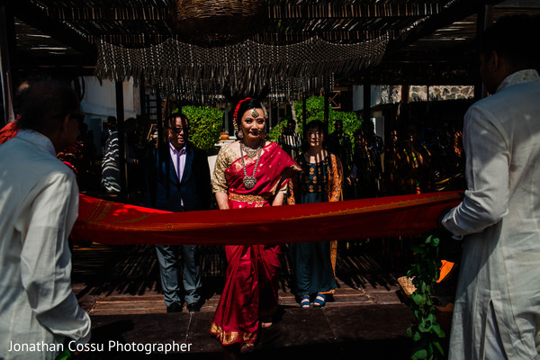Stunning entrance of Indian bride to ceremony.