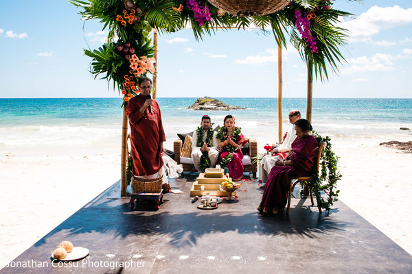 Indian bride and groom by the beach ceremony.