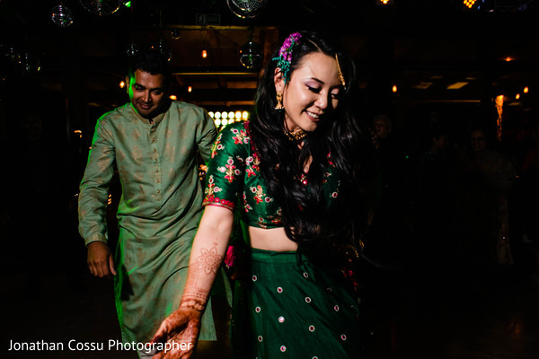 Lovely Indian couple at sangeet dance capture.