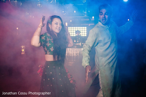 Indian couple at their upbeat sangeet celebration.