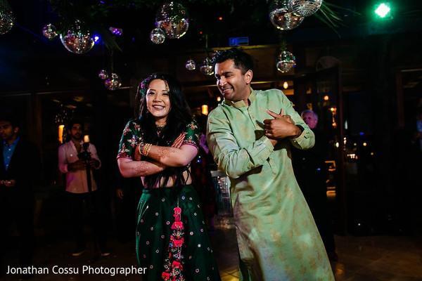 Enchanting Indian bride and groom dance.
