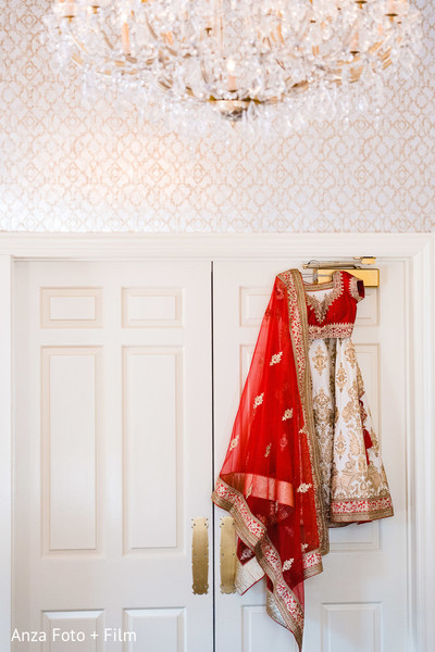 Incredible Indian bridal red ghoonghat and lehenga outfit.