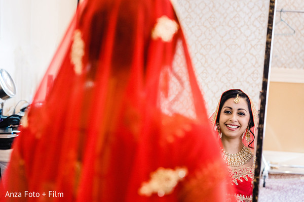 Capture of Indian bride looking in the mirror.