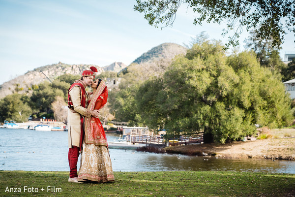 Gorgeous Indian bride  and groom in traditional outfits.
