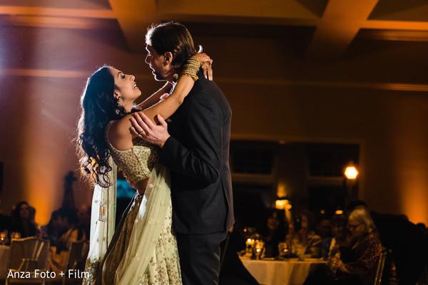 Indian lovebirds dancing at reception.