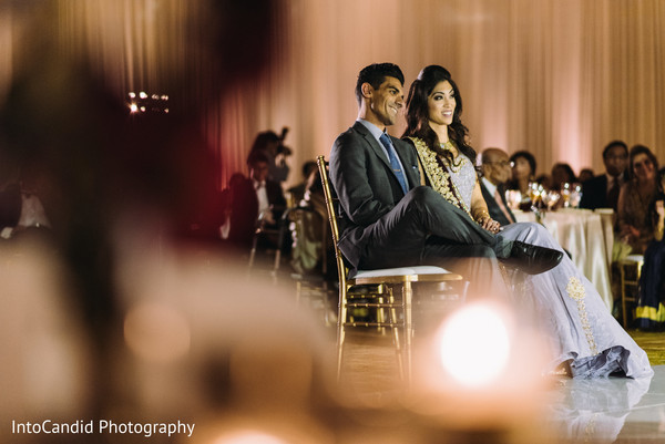 Charming Indian couple enjoying their reception.