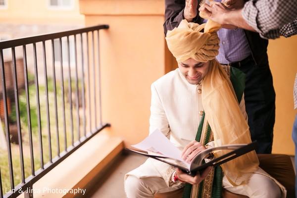 Indian groom preparing his wedding outfit.