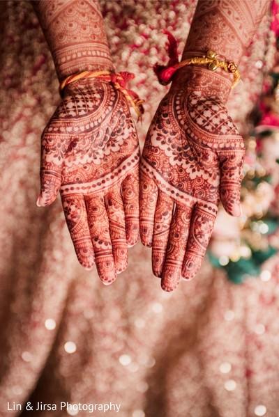 Intricate reddish bridal henna.