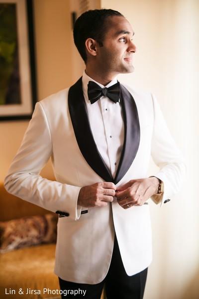 Indian groom's white tuxedo jacket.