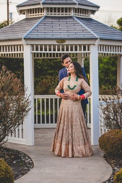 Elegant Indian couple posing outdoors.