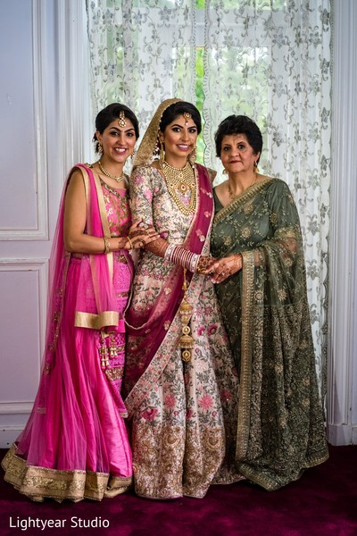 Bride posing with her family