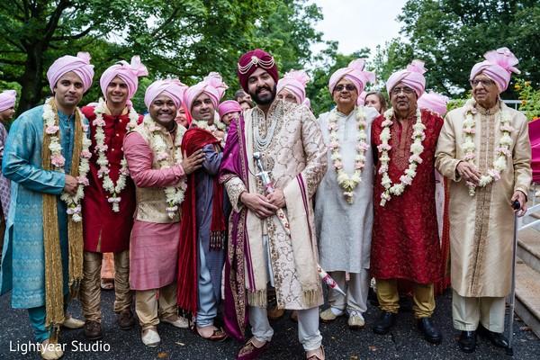 Raja with groomsmen outdoors