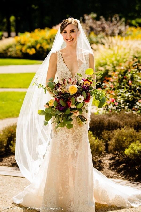 Indian bride on her white wedding dress photo.