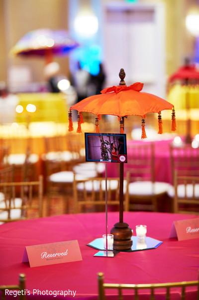 Sweet sangeet table umbrella decor.