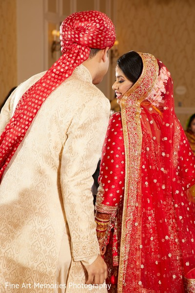 Indian bride and groom with the attires