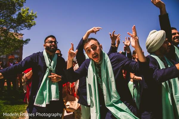 Indian groomsmen at baraat dance capture.