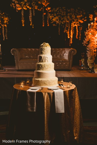 Elegant Indian wedding cake decor.