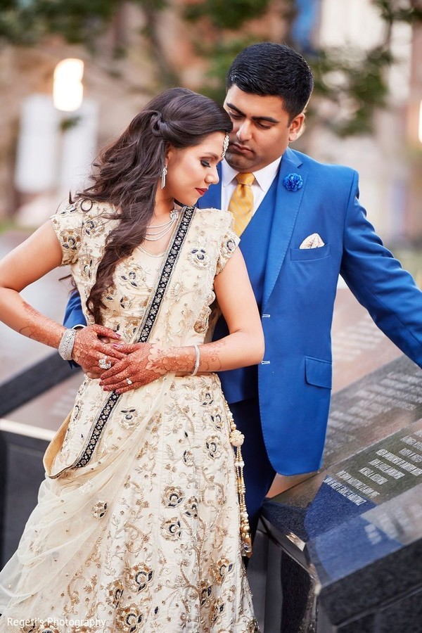 Indian couple posing outdoors capture.