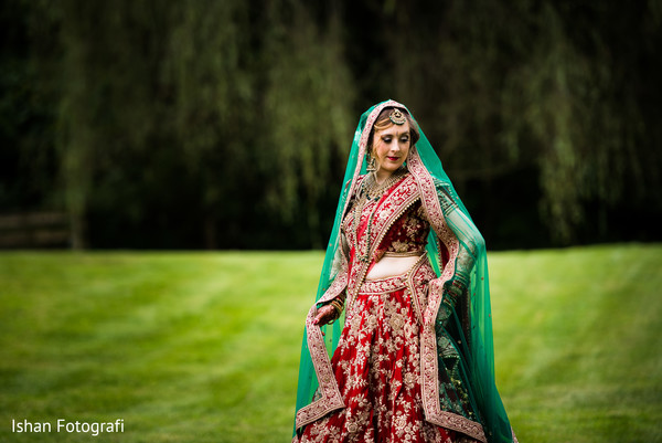 Maharani posing with her ceremony outfit.