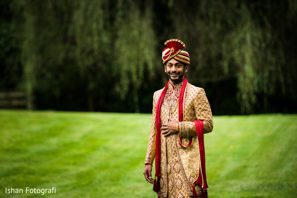 Rajah outdoors on his wedding ceremony outfit.