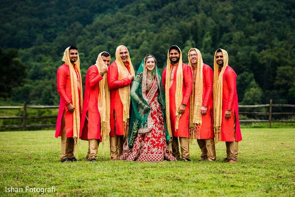 Indian bride, and groomsmen outdoors capture.