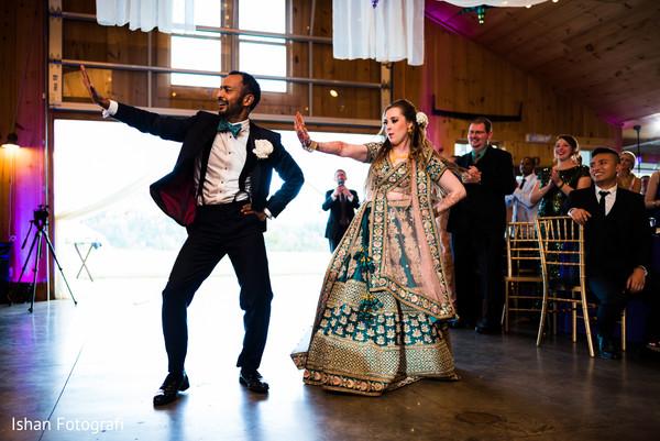 Splendid Indian couple dance at reception.