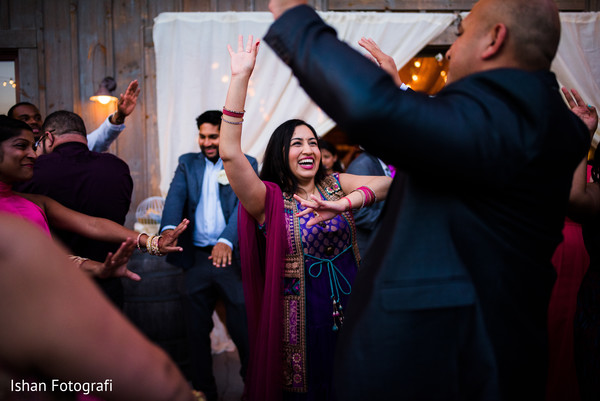 Indian wedding guests celebrating during reception party.