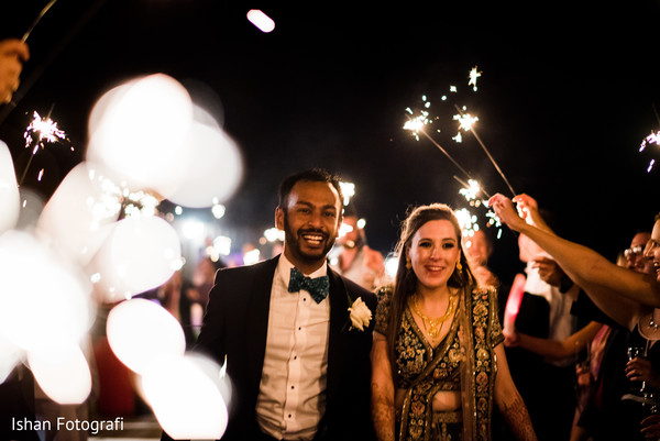 Joyful Indian lovebirds at reception capture.