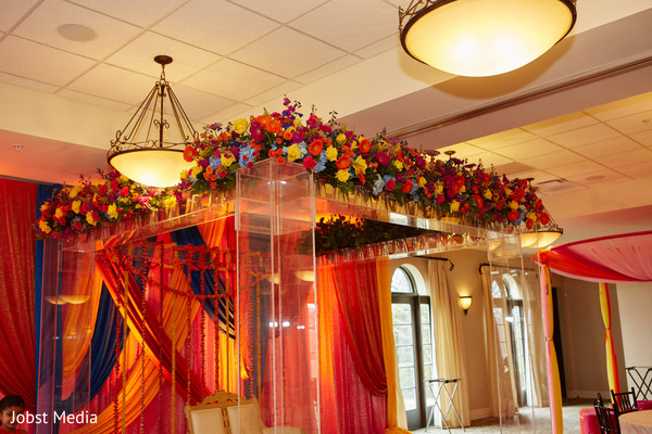 Incredible mandap flowers decoration for pre-wedding party.