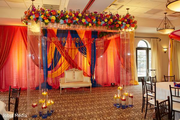 Incredible orange, yellow and blue mehndi party decor.