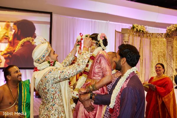 Indian couple at pre wedding rituals.