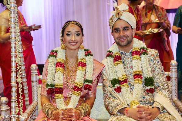 Lovely Indian couple at their Jaimala ritual.