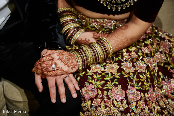 Closeup capture of Indian couple showing their wedding rings.