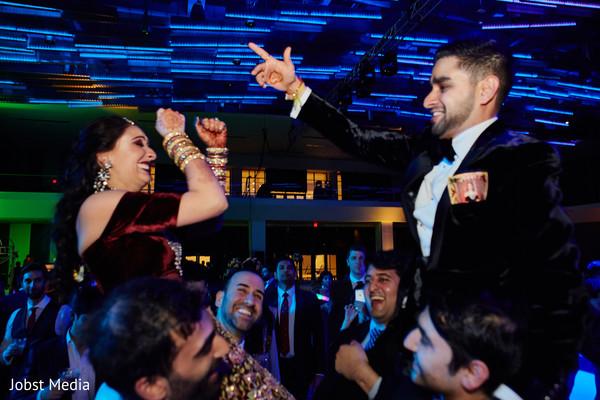 Joyful Indian couple at reception celebration.