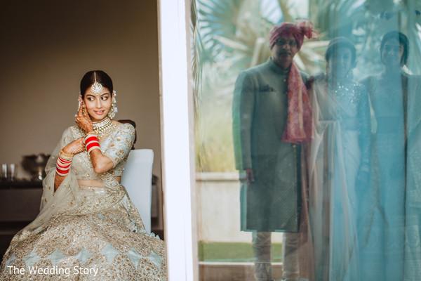 Enchanting Indian bride getting her earrings on.