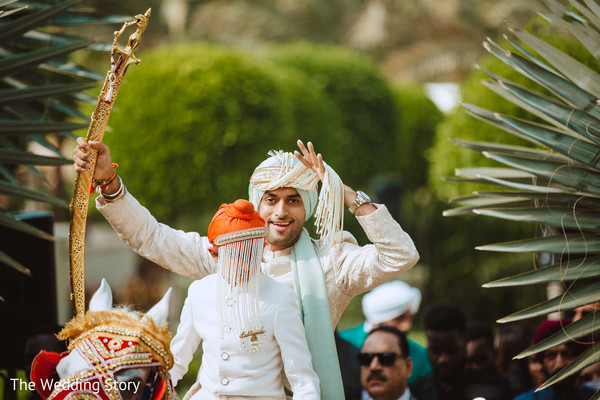 Dreamy rajah on his white horse for his baraat celebration.