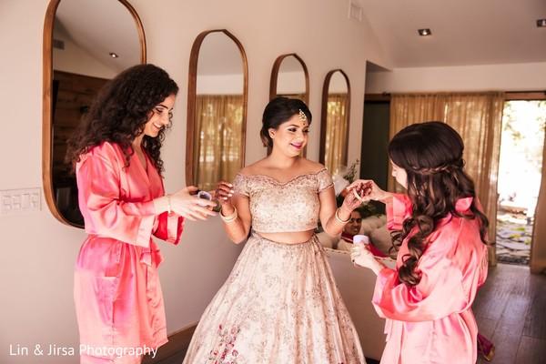 Maharani getting help to put on her chooras.