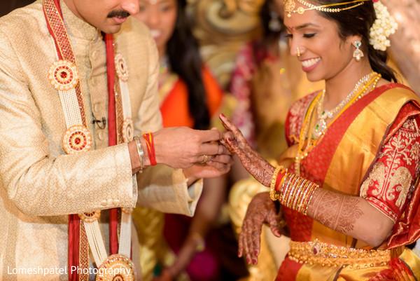 Maharani and Indian groom interchanging rings