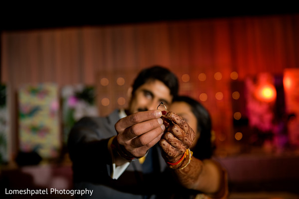 Indian bride and groom showing their mehndi