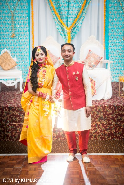Maharani and Indian groom posing for pictures