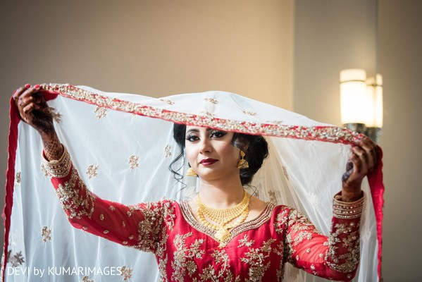 Indian bride posing for pictures
