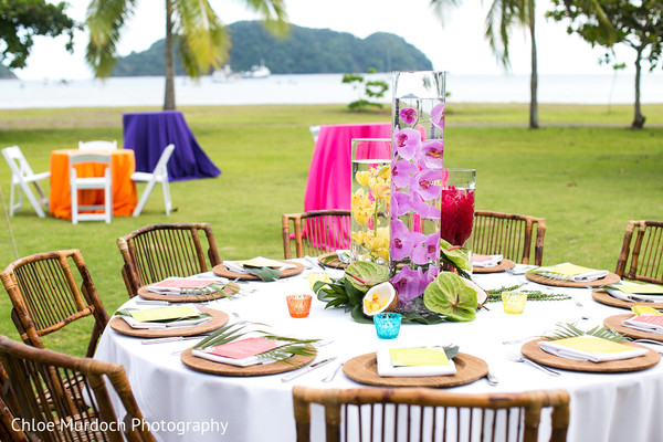 Colorful sangeet table centerpiece decoration.