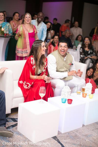 Joyful couple at sangeet celebration.