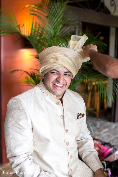 Charming Indian groom getting his turban on.