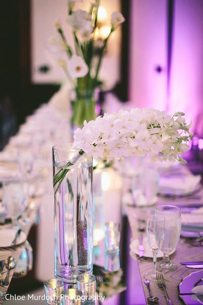Stunning indian wedding table white flowers decor.