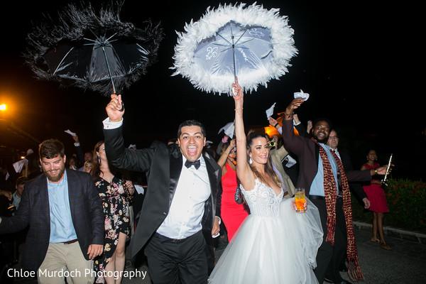 Upbeat Indian wedding reception celebration.
