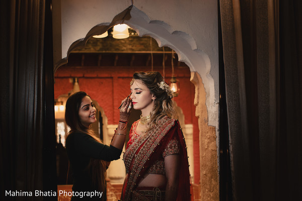 Lovely Indian bride getting her hair and makeup done.