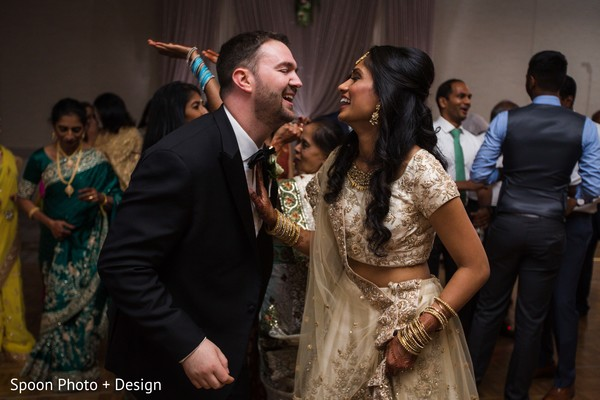 Indian couple dancing at their reception.