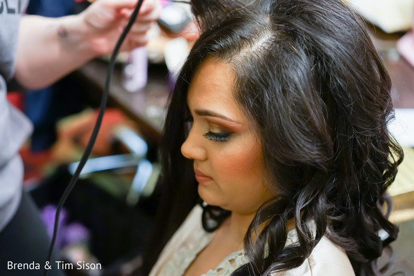 Lovely Indian bride getting her hair done.